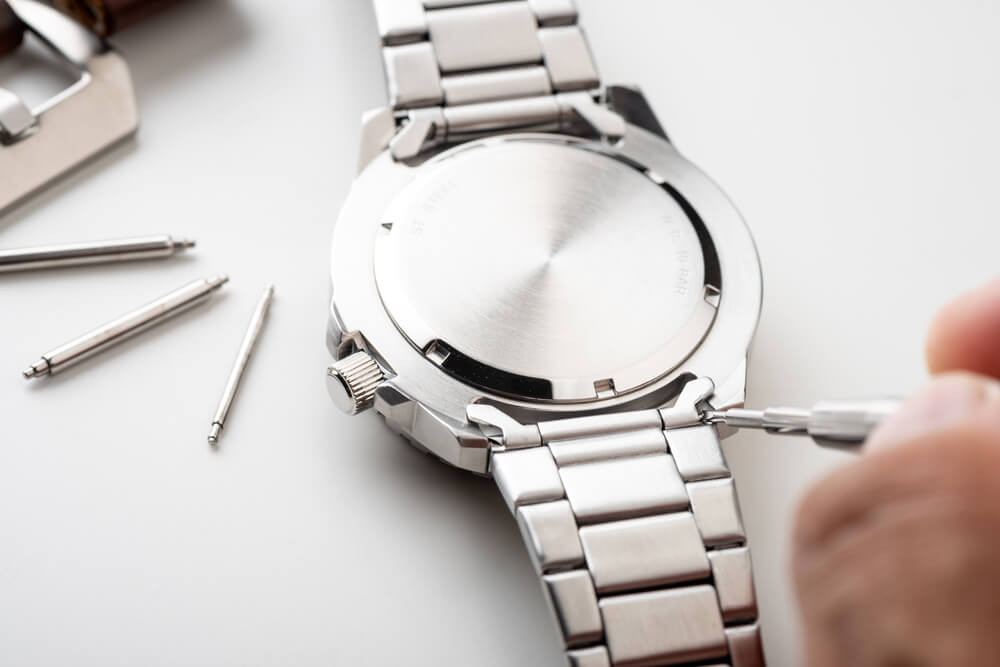 silver watch with spring bars on side